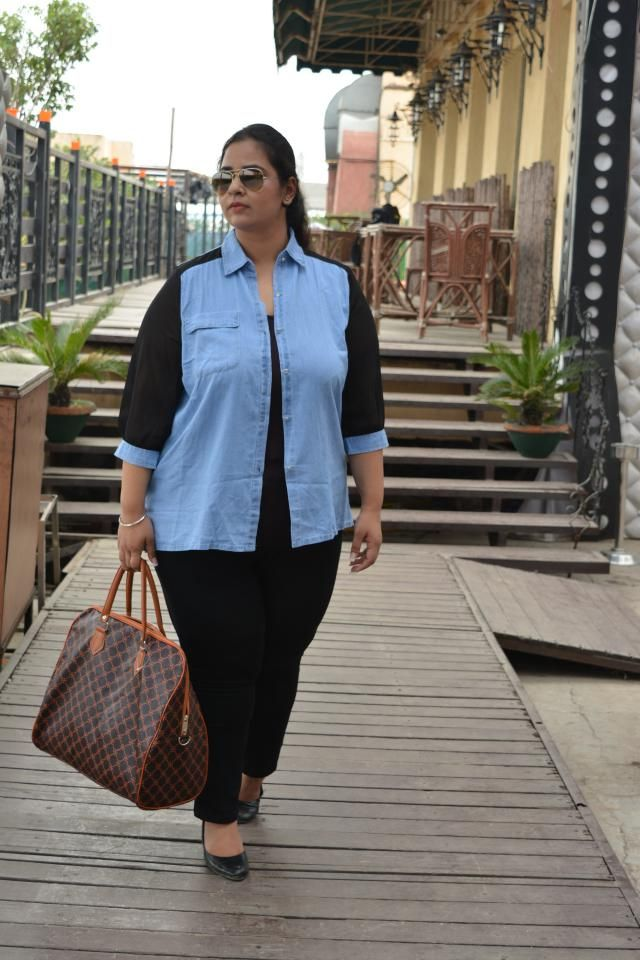 This blue denim shirt with black see through sleeves is the perfect semi-formal look. I love dressing it up with a stat…