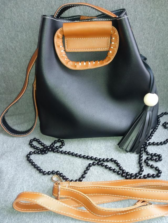 http://www.zaful.com/tassel-wood-ball-pu-leather-handbag-p_226861.html