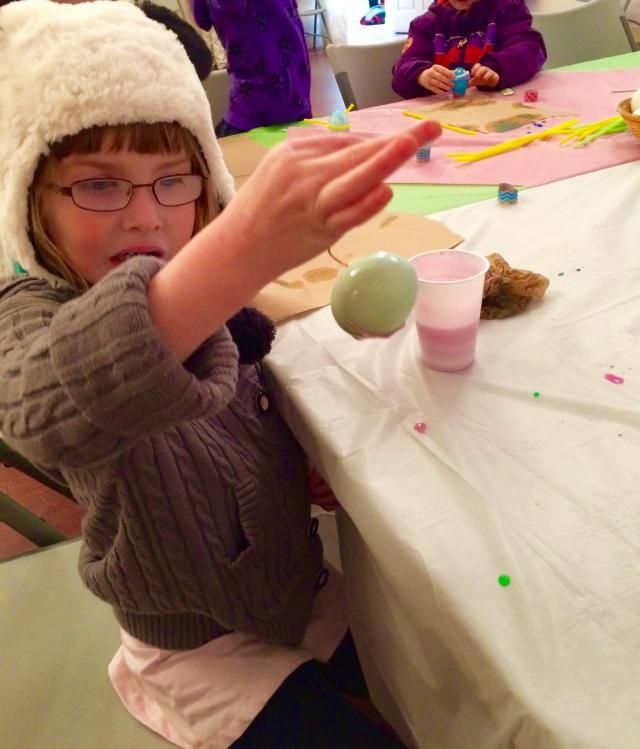 Just a sweet girl in a Panda Hat, colouring Easter Eggs!