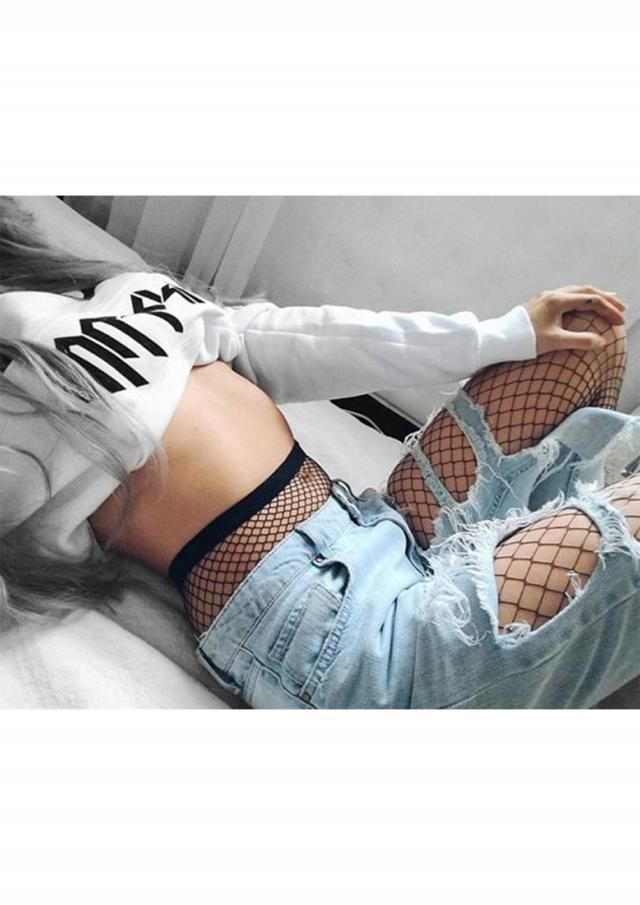 ripped jeans and fishnet tights