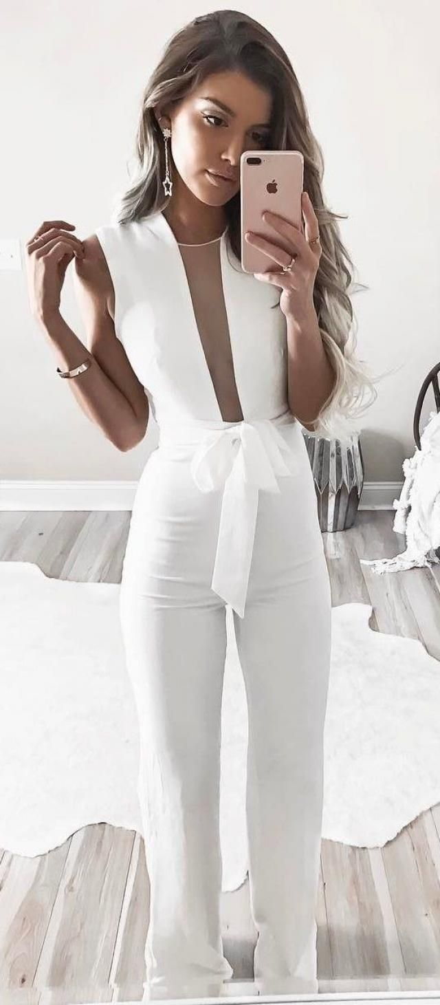 beautiful woman in white overalls