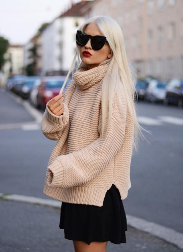 Black skirt, sweater and nice black sunglasses are ideal combination