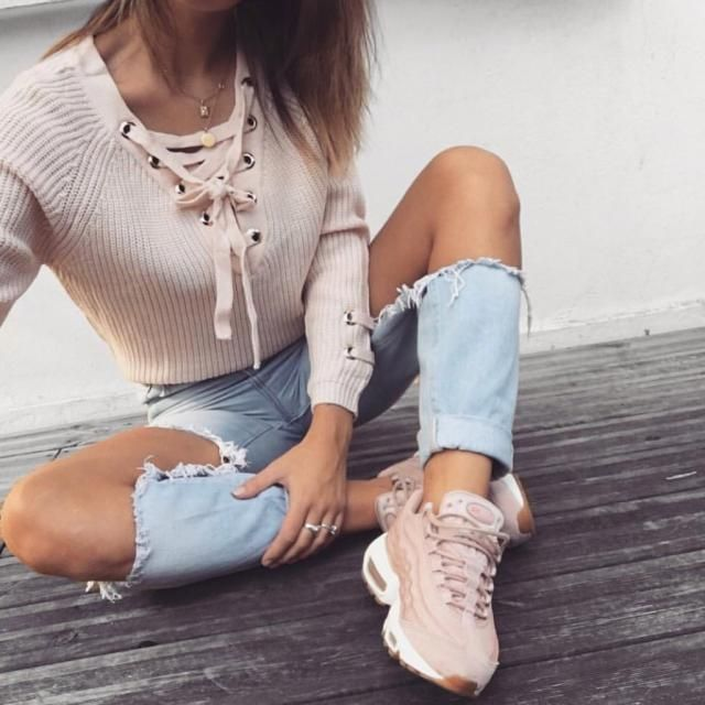cute outfit lace up sweater and ripped jeans