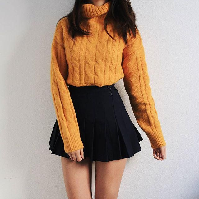 this outfit is gorgeous the orange turtleneck sweater with a black skirt so cute what do you think?