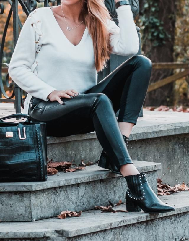 Details of the look wearing bag and sweater and boots