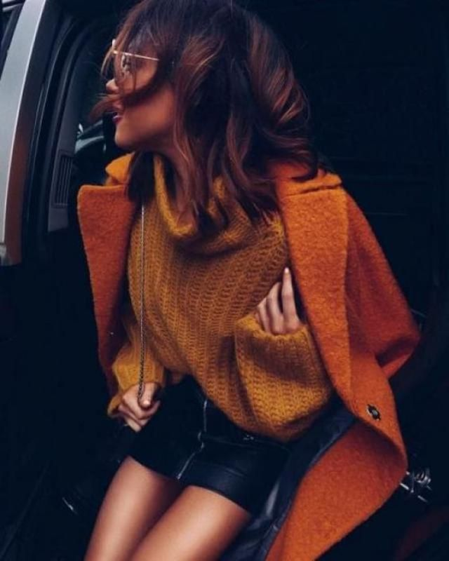 I adore this mustard yellow sweater combination with orange coat and black leather skirt. What do you think?