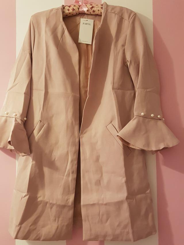 Pink pearl coat.
