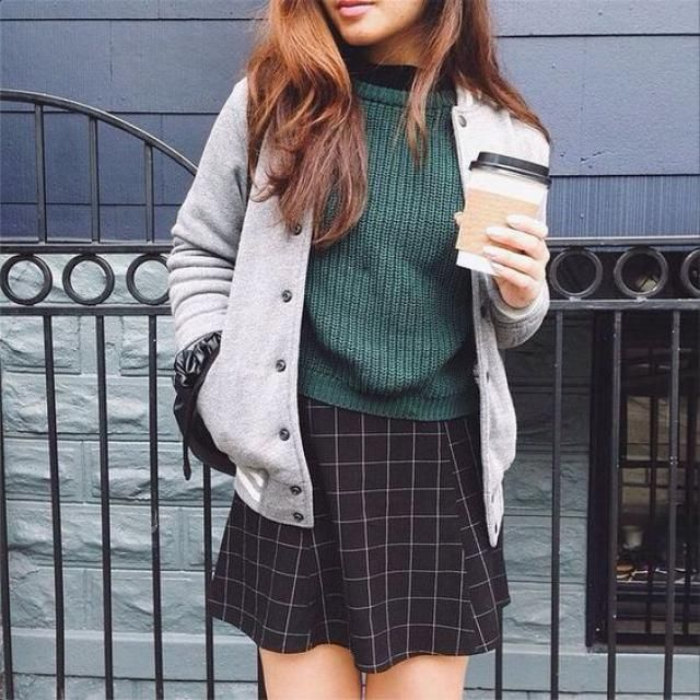 For a casual chic look try this plaid skirt with a green sweater and a Baseball Jacket
