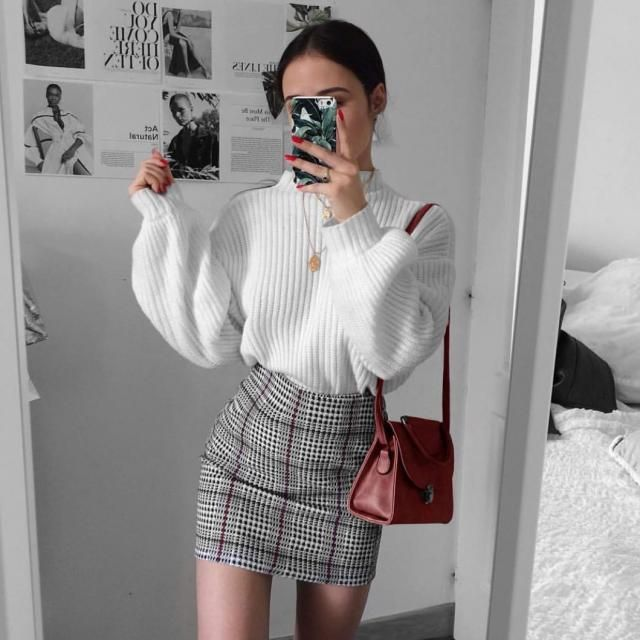Keep it chic and fancy with this plaid skirt and white sweater
