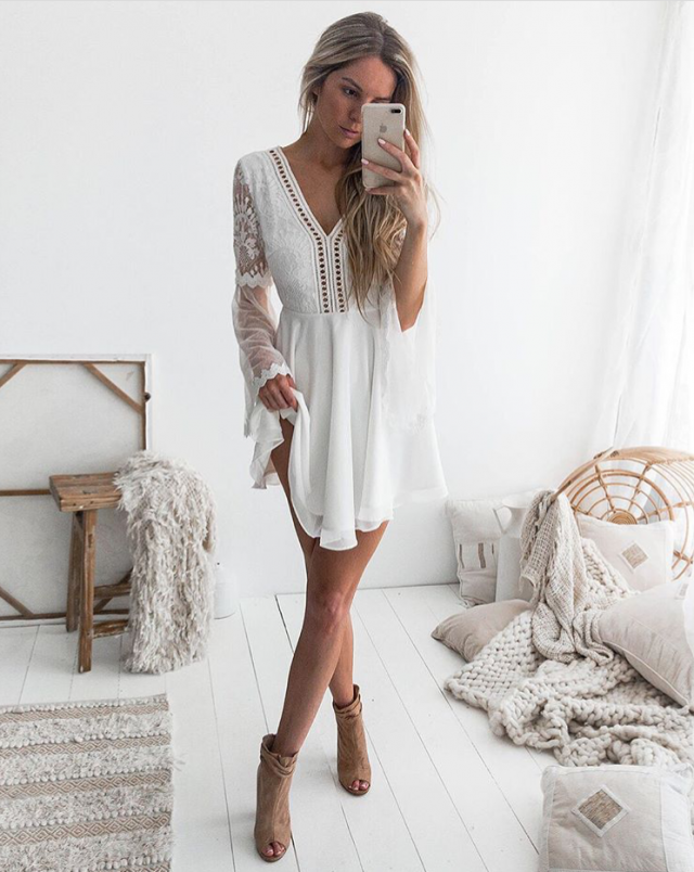 This is a cute lace dress that is perfect for a beach vacation