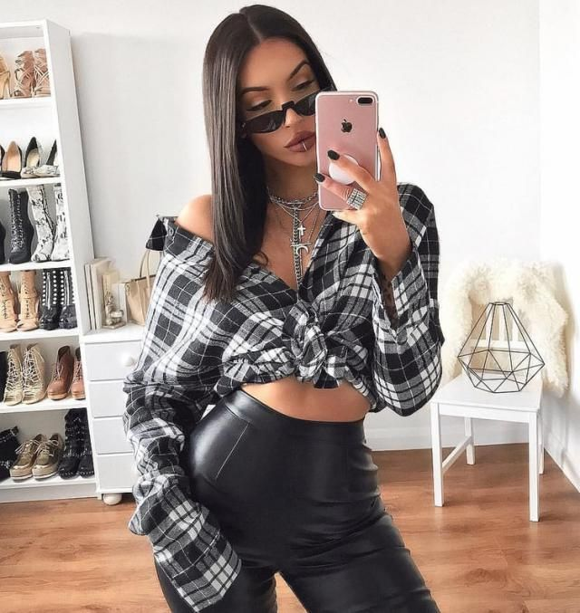 For a sexy badass look try this outfit it's so simple a plaid blouse with faux leather pants and some atittude