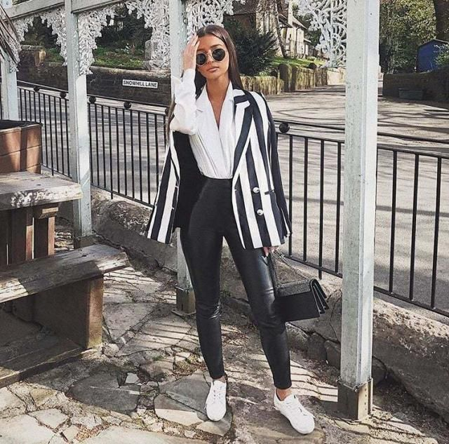 Keep it chic and cute with this unique striped blazer