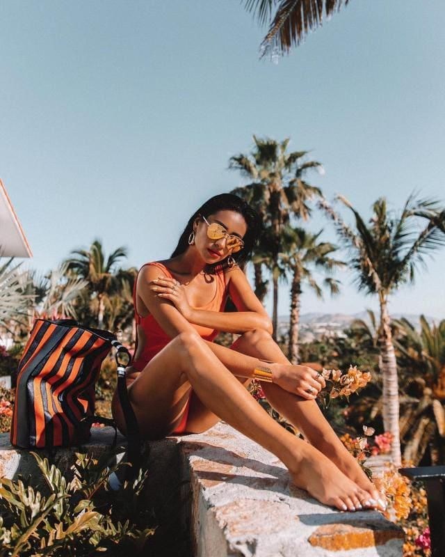 This dreamy swimwear looks like everything I imagine summer to look like. The orange compliments Shay's skin tone and l…