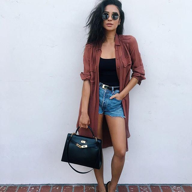Denim shorts and black casual top
