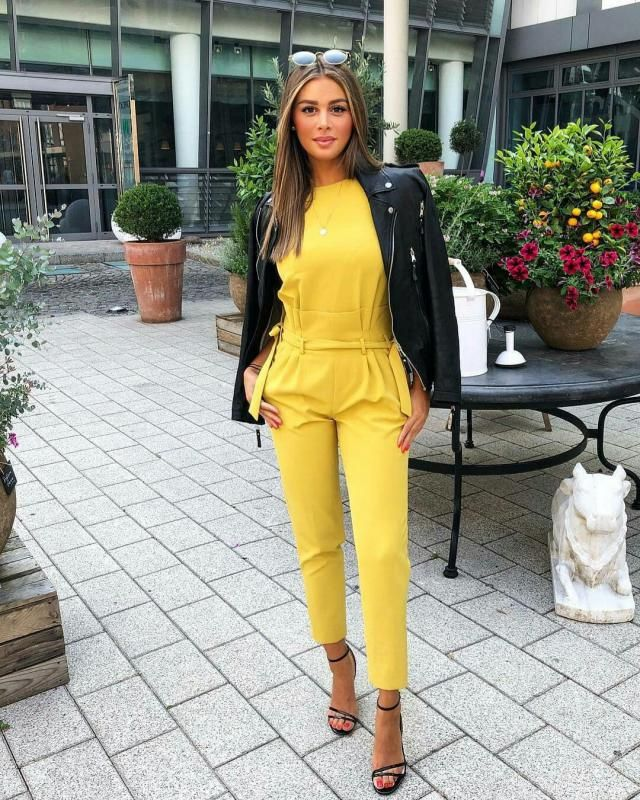 Wear a faux leather jacket over a yellow gorgeous jumpsuit for an elegant fun look