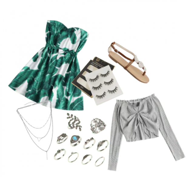 Green leaf dress, silver necklace, multiple silver rings, gray long sleeve top, false lashes, medium brown sandals