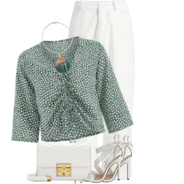 Beautiful feminine blouse - great addition to the white pants and sandals