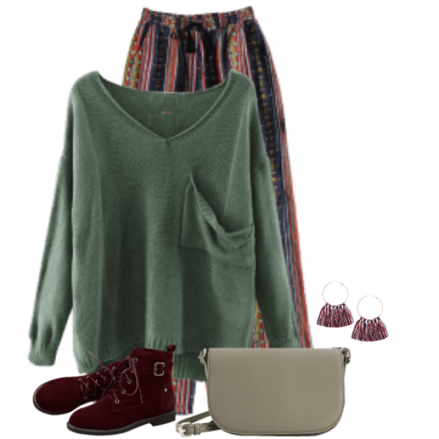 Beautiful combo with this green knitted sweater and the striped colourful pants