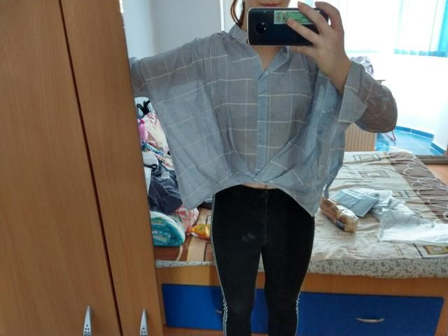 it's pretty see through but I like the blouse. it's huge tho. I bought an M but I should have gotten a S