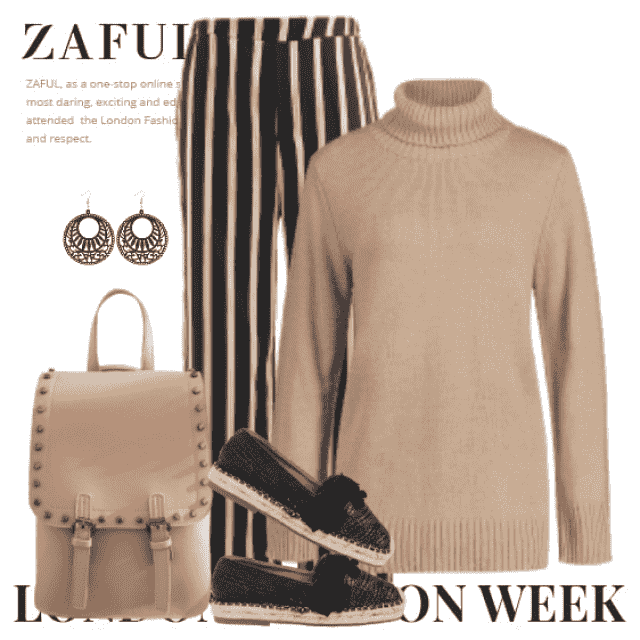 Fabulous and chic look here with the knitted sweater and the striped pants