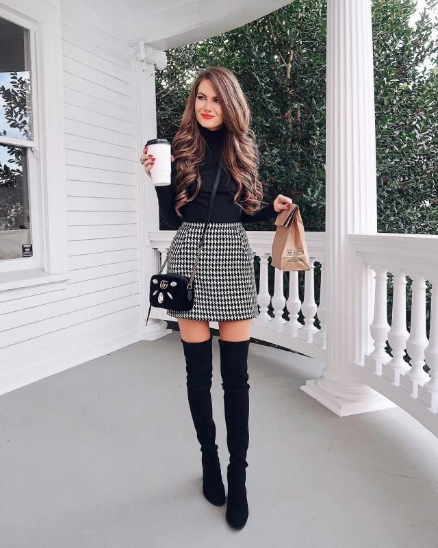 Get this plaid skirt with a black turtleneck sweater for a stylish elegant outfit