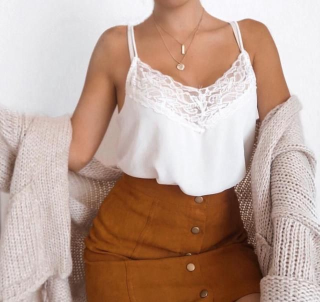 If you're getting ready for a date then throw this khaki cardigan over your lace tank top and brown skirt for an elegan…