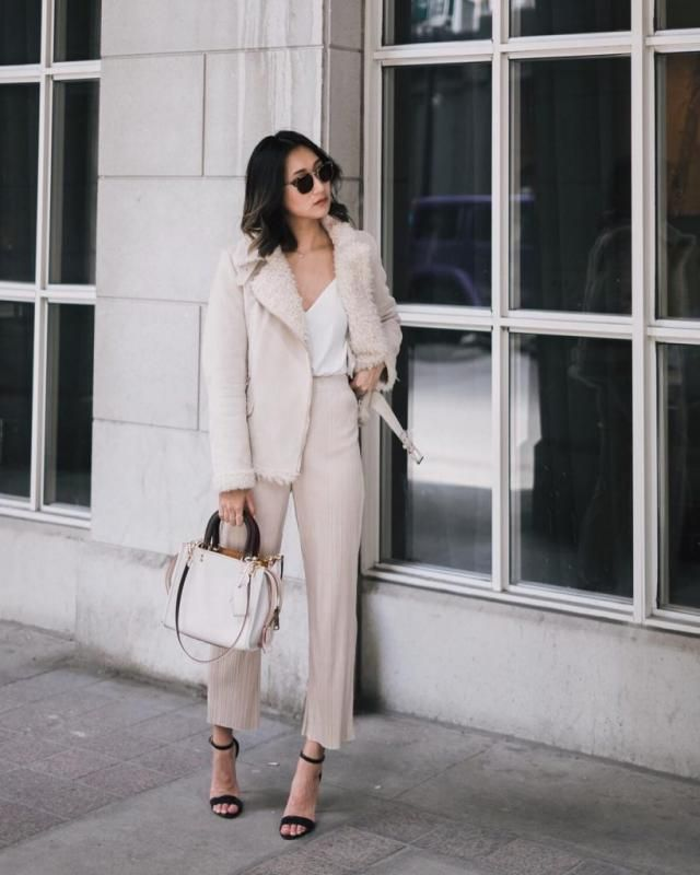 Pants Beige  And Coat This is outfit consists of a jacket with fur collar beige, a white V neck cami, and a pair of wi…