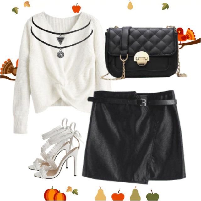 So elegant and modern look.The black white combination is an unmistakable choice,black skirt and white sweater with bag…