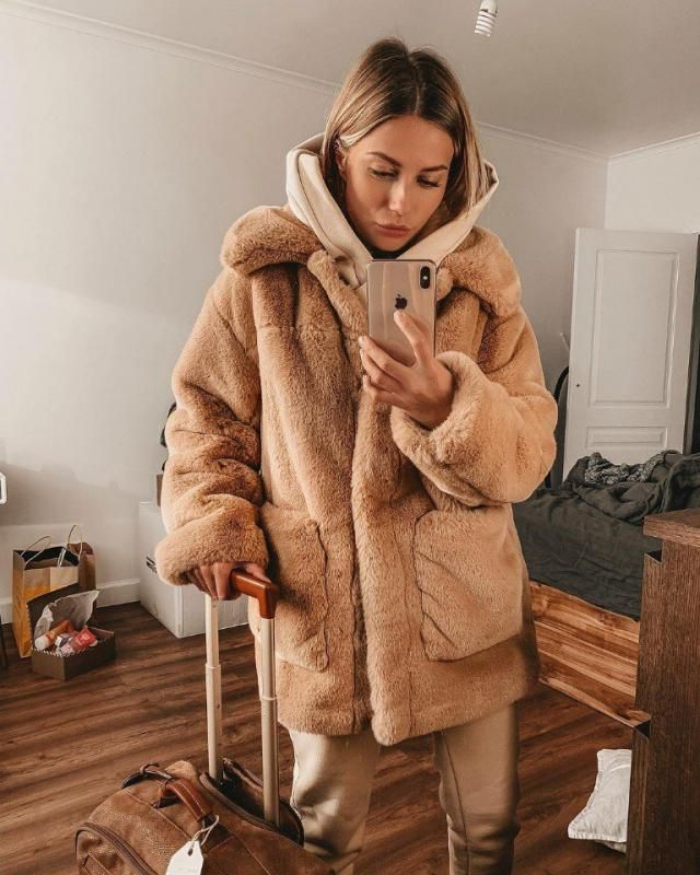 Gorgeous neutral outfit consist of fluffy khaki coat, a beige comfy hoodie and a pair of khaki pants