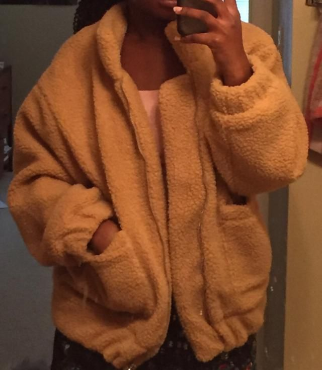 I really like this jacket. I'd recommend getting it in your size since it already has an oversized fit. The material f…