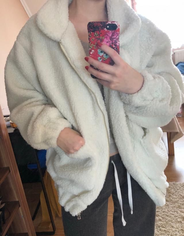 The coat fits me pretty well although it's a little tight around my hips and wrist. The material is soft. Love it, ver…