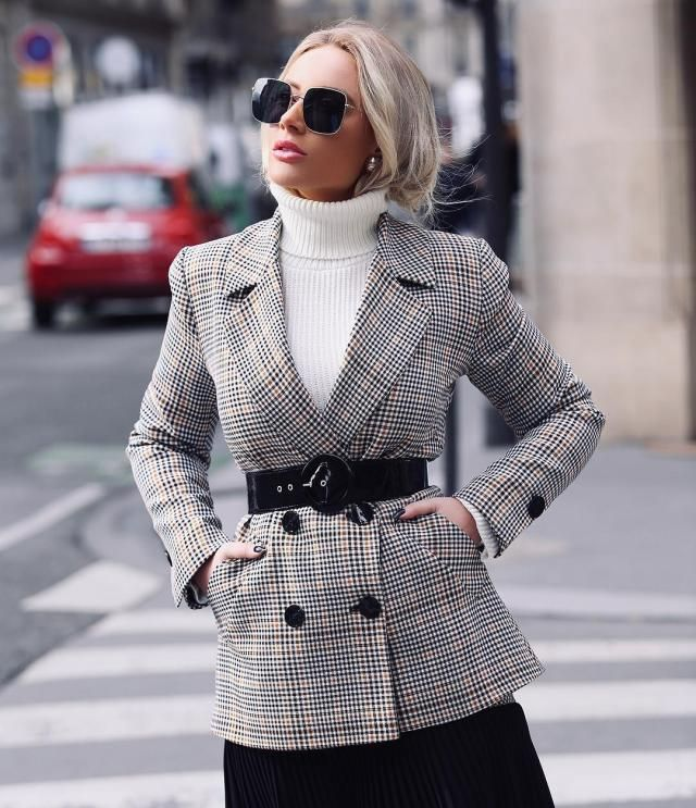 For a smart, layered look, get a plaid blazer and wear it over a white turtleneck sweater