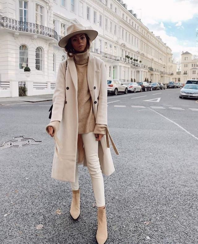 Stun anyone who is looking when you step out in a long beige coat over a khaki turtleneck sweater and beige pants with …