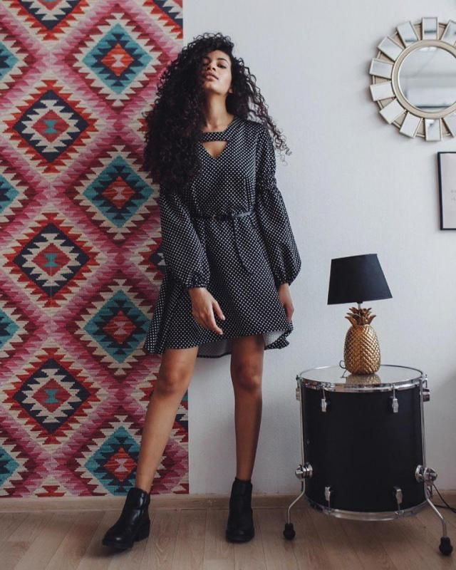 Go feminine and girly by pairing your polka dot dress with a black short boots