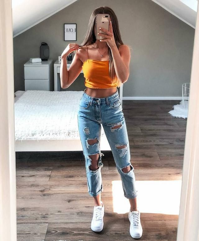 for a baddie cool casual look try this orange tank top with ripped jeans,