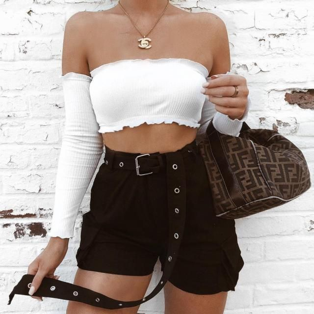 Keep it sexy and chic with this off shoulder top and black shorts