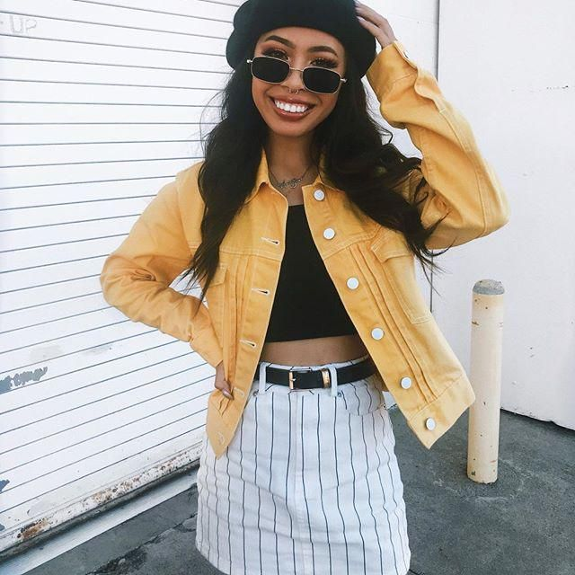 Keep it fresh and casual with this yellow jacket and striped skirt