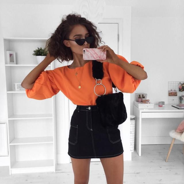 For an effortless chic feminine look try an orange cute top with denim skirt