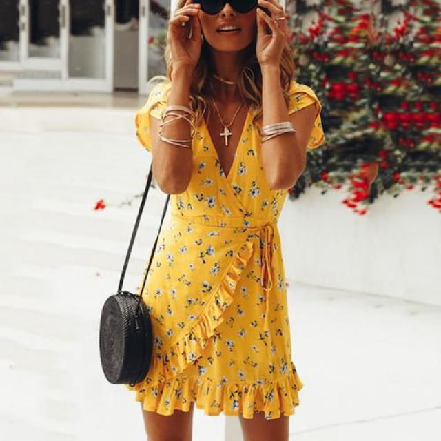 She&;s looking fabulous in this gorgeous yellow dress, you can find the same dress at Zaful.com