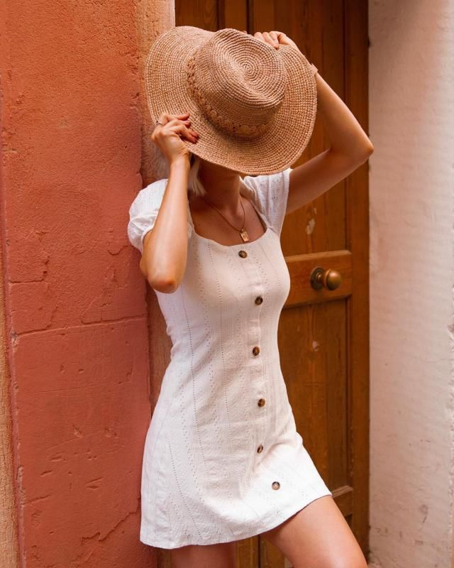 Sometimes all you need is a simple button up white dress for a classy feminine look
