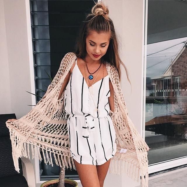 Try wearing a stylish striped romper for the perfect summer vacation look