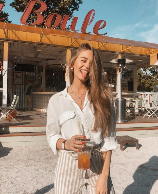 For another casual outfit, coordinate a white simple button up blouse with a Belted Striped High Waisted Tapered Pants …