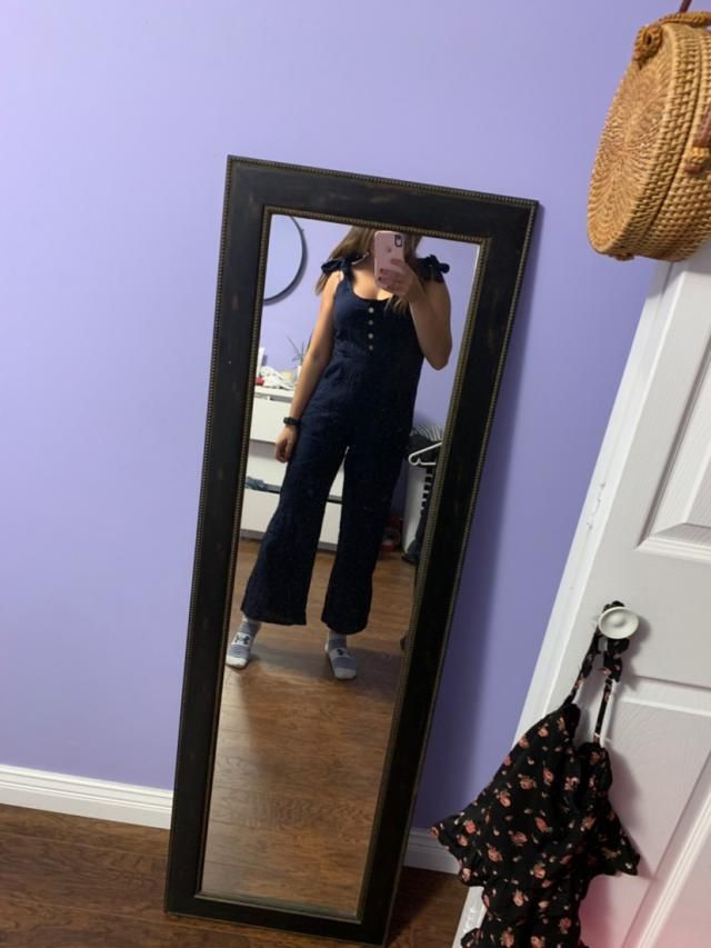 Love this jumpsuit and fits surprisingly well!! Would be super cute with a mock neck underneath.