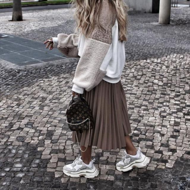 Pleated skirt with sneakers and a sweater