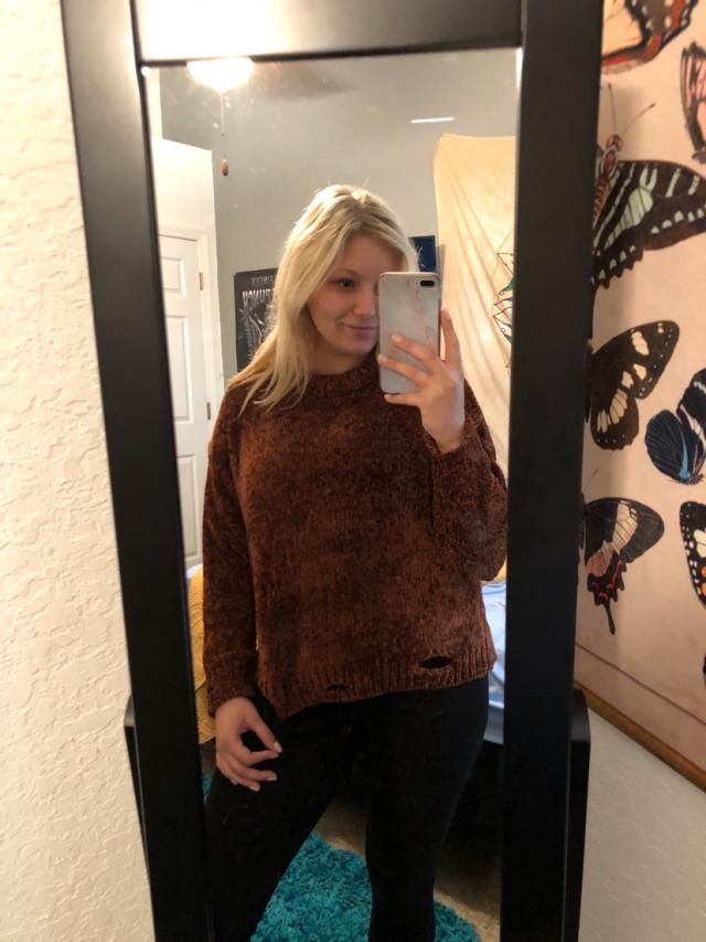 This sweater is the cutest color and has rips near the bottoms for an awesome distressed look. Fits true to size. Perf…
