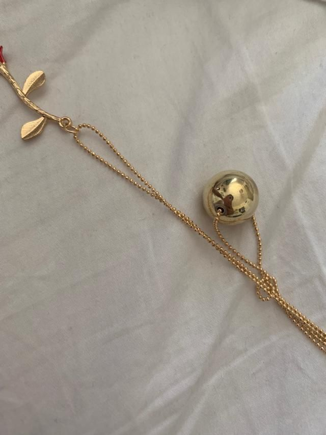 Looks very cheap. The gold ball is MASSIVE and the chain is plastic!