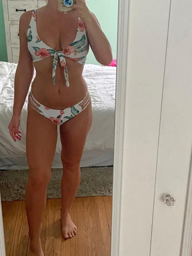 Full coverage suit. Top ties in the front, so it's adjustable. Bottoms fit cute and have a braided detail that's adora…
