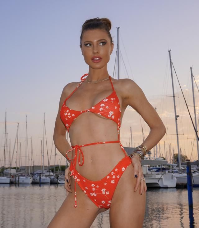 AMAZING LOOK! This bikini is made like a two piece but with strings attaching both parts. soooo cute. The fabric is sup…