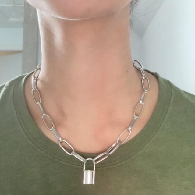 Goes well with anything... the pendant isn't too big (about an inch) and the clasp can fit on the chain links if you w…
