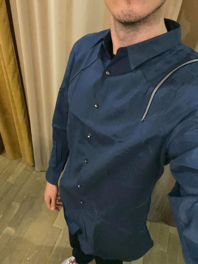 I am wearing American size M, and XL fits me well. The only thing I don't like is the buttons which are gold. Material…
